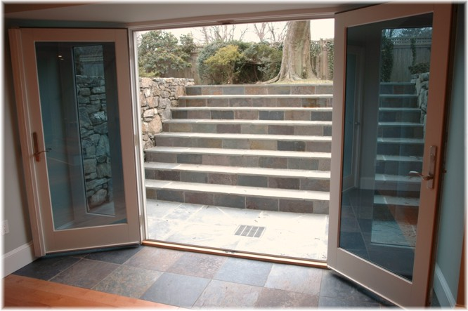 Westchester NY design build walk out French doors basement contractor
